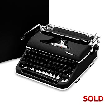 Black 1960 Olympia SM4 S Manual Typewriter with Case (11 characters/inch) #1044