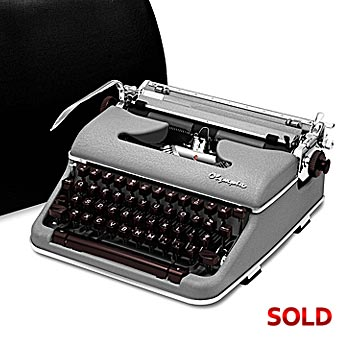 Gray 1959 Olympia SM4 S Manual Typewriter with Case (11 characters/inch)