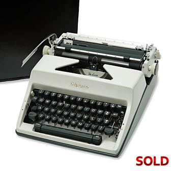 Gray 1969 Olympia SM9 De Luxe Manual Typewriter with Case